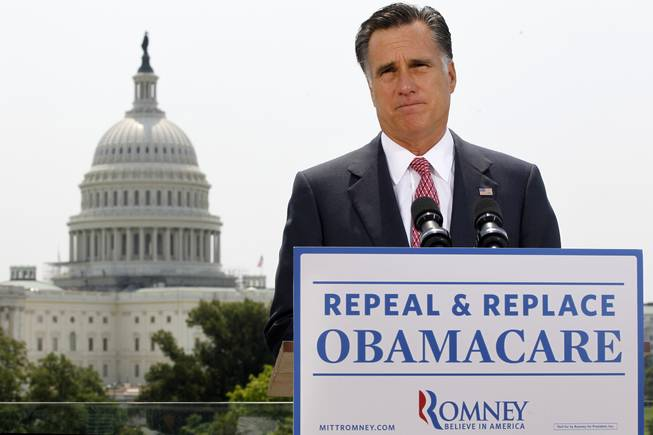 With the Capitol in the background, Republican presidential candidate Mitt Romney speaks about the Supreme Court's health care ruling, June 28.
