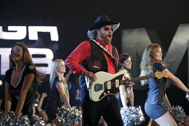 Hank Williams Jr. performs during the recording of a promo for NFL Monday Night Football in Winter Park, Fla., Thursday, July 14, 2011.  Williams recorded the promo despite the fact that the upcoming season still remains in limbo.