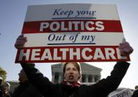 Amy Brighton from Medina, Ohio, who opposes health care reform, rallies in front of the Supreme Court  in Washington, Tuesday, March 27, 2012, as the court continues arguments on the health care law signed by President Barack Obama.