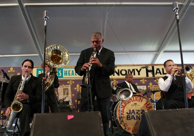 In this Saturday, May 5, 2012 photo, the Preservation Hall Jazz Band performs at the New Orleans Jazz and Heritage Festival in New Orleans. For five decades, Preservation Hall has served up New Orleans jazz for music lovers the world over. The New Orleans Jazz and Heritage Festival, on its closing weekend, marked that achievement by showcasing the world-renowned Preservation Hall Jazz Band in concert twice.