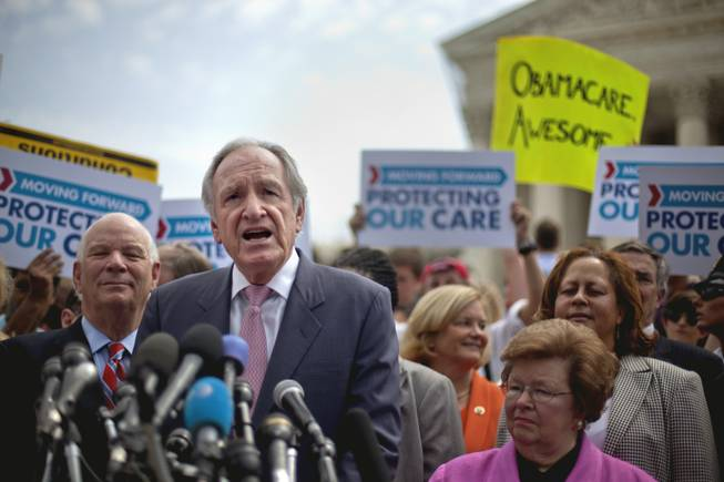 Senate Health, Education, Labor and Pensions Committee Chairman, Sen. Tom Harkin, D-Iowa, center, flanked by Sen. Benjamin Cardin, D-Md., left, and Sen. Barbara Mikulski, D-Md., speaks outside the Supreme Court in Washington, Thursday, June 28, 2012, after the court's ruling on President Barack Obama's health care law was announced.