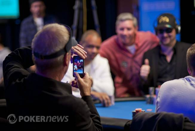 Bobby Baldwin takes a photo of Phil Ivey, Mike Sexton ...