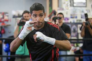 Former WBA and IBF super lightweight champion Amir Khan of Britain shadow boxes during a workout at the Wild Card Boxing Club in Hollywood, Calif. Tuesday, July 3, 2012. Khan is preparing to challenge the undefeated WBC super lightweight champion Danny Garcia for the title at the Mandalay Bay Events Center on July 14.