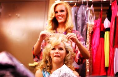 Miss Nevada competitor Diana Sweeney, top, of Reno helps teen competitor Jordan Lamoreaux of Carson City make her hair large backstage before the Miss Nevada and Miss Nevada's Outstanding Teen 2012 competition at the Casablanca Resort and Casino in Mesquite on Tuesday, July 3, 2012.