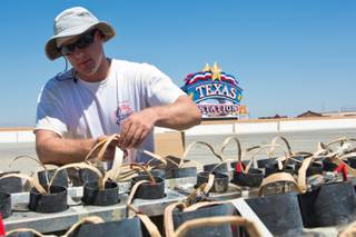Chris Wasco, pyrotechnician for Grucci's of New York, is rigging shells for Texas Stations' July 4th fireworks show, Tuesday July 3, 2012.