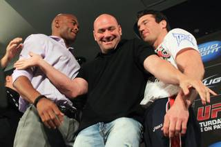 UFC president Dana White steps in to separate UFC middleweight champion Anderson Silva, left, and challenger Chael Sonnen as they face off after a news conference to promote their bout at UFC 148 Tuesday, July 3, 2012.