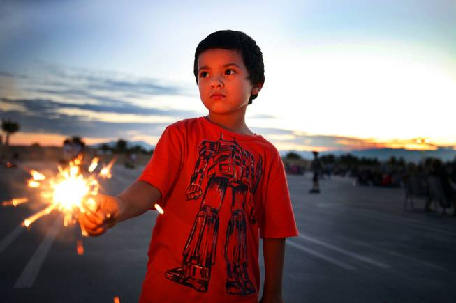 Mario Bibriesca, 5, of North Las Vegas holds a sparkler while waiting for the Independence Day fireworks on top of the Paseo Verde parking garage at Green Valley Ranch Casino in Henderson on Wednesday, July 4, 2012.