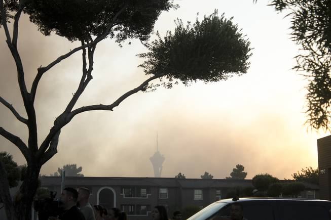 Smoke is seen from a nearby apartment fire on Karen Avenue near Maryland Parkway and Sahara Avenue, July 5, 2012.