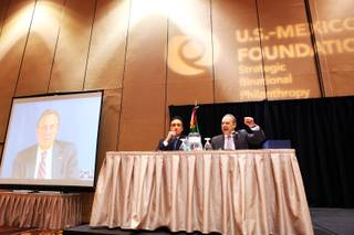 Earl Anthony Wayne, from left, United States ambassador to Mexico via Skype from Mexico, moderator Henry Cisneros and Arturo Sarukhan, ambassador of Mexico to the United States, participate in the U.S.-Mexico Foundation's Ambassadors Panel at Mandalay Bay in Las Vegas on Friday, July 6, 2012.