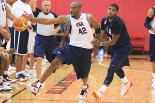 Kobe Bryant reaches for a ball while being guarded by Kyrie Irving during the USA Olympic basketball team practice Friday, July 6, 2012 at UNLV's Mendenhall Center.