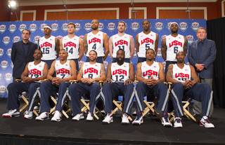 USA Basketball head coach Mike Krzyzewski, left, and USA Basketball Chairman Jerry Colangelo, right, flank the twelve players selected for the 2012 U.S. Olympic mens basketball team during a news conference at the Wynn Las Vegas Saturday, July 7, 2012.  Back row (L-R) Carmelo Anthony, Blake Griffin, Tyson Chandler, Kevin Love, Kevin Durant, and LeBron James. Front row (L-R) Chris Paul, Russell Westbrook, Deron Williams, James Harden, Andre Iguodala, and Kobe Bryant.
