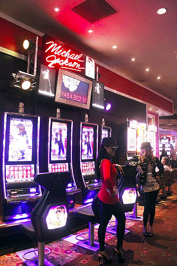 Victoria Falcon (in red) and Cecilia Isberg (in black) donned Michael Jackson costumes July 7, 2012, at Treasure Island to help Bally promote a new slot machine themed after the King of Pop. The Michael Jackson slot just began hitting the Las Vegas casinos within the past two weeks.