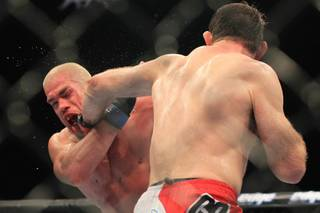 Forrest Griffin nails Tito Ortiz with a left during their light heavyweight fight at UFC 148 Saturday, July 7, 2012 at the MGM Grand Garden Arena. Griffin won a unanimous decision in what was Ortiz's retirement fight.