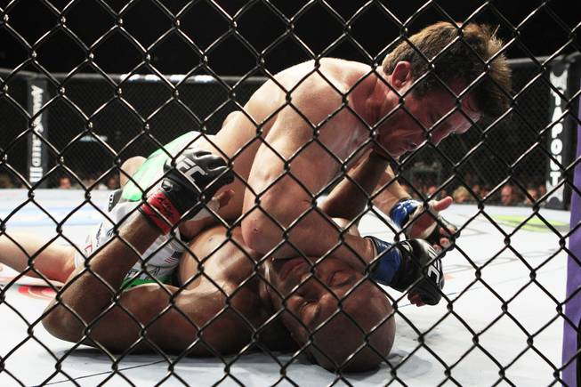 Chael Sonnen lands an elbow to the head of Anderson Silva during their bout at UFC 148 Saturday, July 7, 2012 at the MGM Grand Garden Arena.