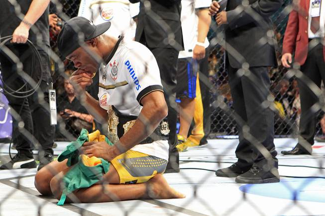 Anderson Silva says a prayer after defeating Chael Sonnen in their bout at UFC 148 Saturday, July 7, 2012 at the MGM Grand Garden Arena.