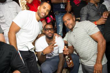 LeBron James, center, celebrates his first NBA championship at Tao in the Venetian on Saturday, July 7, 2012.