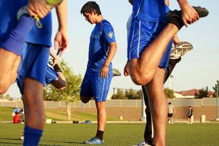 Ruben Duran, center and members of Players SC 94 stretch before practice at the Kellogg-Zaher Soccer Complex near Buffalo and Washington in Summerlin Monday, July 10, 2012. Players SC 94, a youth soccer team of recent high school graduates training for US Nationals, won the regionals in June to become the first Nevada team to advance to regionals.