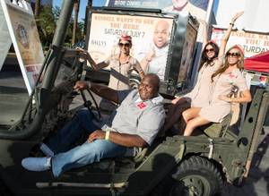 Windell Middlebrooks with the Miller High Life girls in front of Bally's.