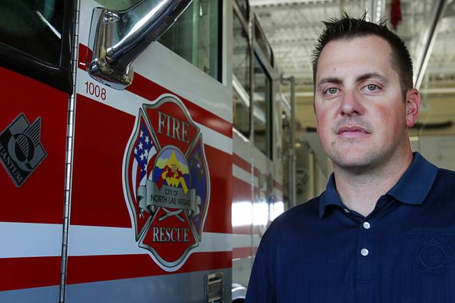 North Las Vegas Fire Capt. Jeff Hurley poses by a ladder truck at Fire Station 56 near Aliante Parkway and I-215 in North Las Vegas Tuesday, July 10, 2012. The station is not always open or open with reduced staff due to staffing problems, Hurley said. The station was open on Tuesday but without a rescue unit.