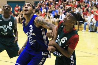 Anthony Marshall and DaQuan Cook fight for a rebound during the Desert Reign summer league Tuesday, July 10, 2012.