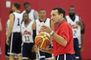 Team USA basketball coach Mike Krzyzewski talks to his team before practice Tuesday, July 10, 2012 at UNLV's Mendenhall Center.