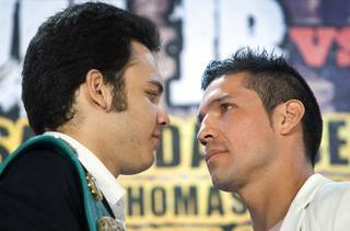 Undefeated WBC middleweight champion Julio Cesar Chavez Jr., left,  of Mexico and Sergio Martinez of Argentina face off during a news conference at the Wynn Las Vegas Wednesday July 11, 2012. Chavez will defend his title against Martinez at the Thomas & Mack Center in Las Vegas September 15 - Mexican Independence Day.