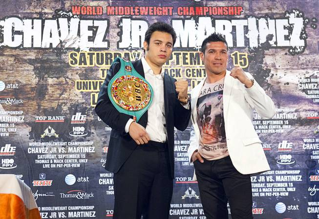 Undefeated WBC middleweight champion Julio Cesar Chavez Jr., left,  of Mexico and Sergio Martinez of Argentina pose during a news conference at the Wynn Las Vegas Wednesday July 11, 2012. Chavez will defend his title against Martinez at the Thomas & Mack Center in Las Vegas September 15 - Mexican Independence Day.