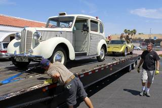 An HBO crew secures cars, once owned by Liberace, onto a car carrier at the Liberace Museum parking lot, Wednesday July 11, 2012. The cars, a 1972 custom Bradley GT and a 1957 London taxi, are on loan to HBO for a project called