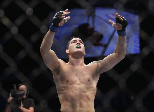 Chris Weidman celebrates after beating Mark Munoz in a UFC on Fuel 4 Mixed Martial Arts middleweight bout in San Jose, Calif., Wednesday, July 11, 2012. Weidman won in the second round.