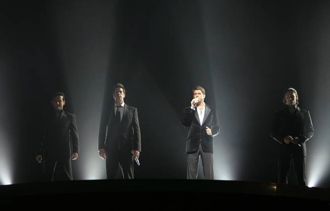 The classical-pop group Il Divo with Carlos Marin of Spain, David Miller of the United States, Sebastien Izambard of France and Urs Buehler of Switzerland, from left to right, performs during a concert at the Hallenstadion in Zurich, Switzerland, Tuesday, June 12, 2007.