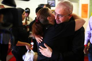 Arturo Martinez hugs family friend Billie Walker before a press conference at his gym the Real KO Boxing Club in North Las Vegas on Thursday, July 12, 2012. Martinez's wife and 10-year-old daughter were beaten to death in their home in April 2012, and Martinez was hospitalized with severe head injuries from the attack.