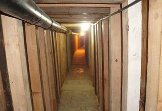 In this undated photo provided by the United States Drug Enforcement Administration, shows a 240-yard, a complete and fully operational tunnel that ran from a small business in Arizona to an ice plant on the Mexico side of the border, Thursday, July 12, 2012, in San Luis, Ariz.