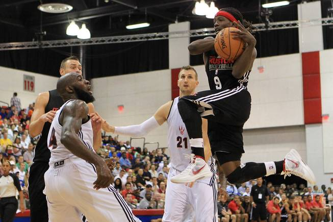 Houston Rockets guard Courtney Fortson drives to the basket during their NBA Summer League game against the Toronto Raptors Friday, July 13, 2012.