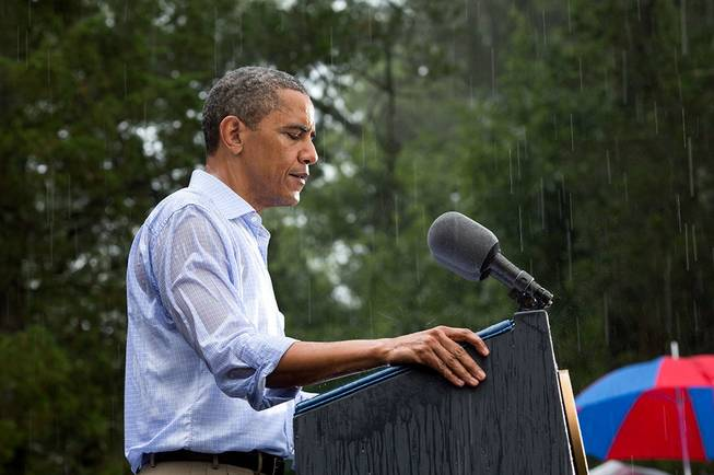 "July 14, 2012.""The President delivers remarks in the pouring rain at a campaign event in Glen Allen, Va. He was supposed to do a series of press interviews inside before his speech, but since people had been waiting for hours in the rain he did his remarks as soon as he arrived onsite so people."""