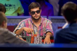 Robert Salaburu, a poker player from San Antonio Texas, competes in the World Series of Poker $10,000 buy-in, no-limit Texas Hold'em main event at the Rio Monday, July 16, 2012