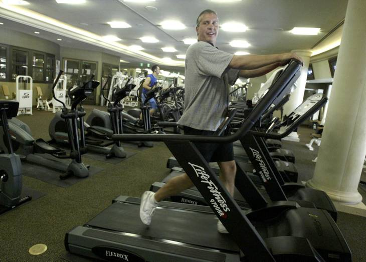 Randy Goldberg works out inside the exercise room of The Stirling Club at Turnberry Place on Monday, May 17, 2004. The exercise room is one of several amenities offered at the high-rise condominium.