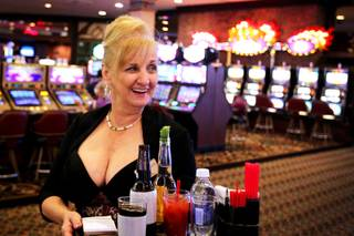 June Drao serves cocktails on the casino floor at Sam's Town in Las Vegas on Tuesday, July 17, 2012. Drao has worked as a cocktail server at Sam's Town for 27 years.