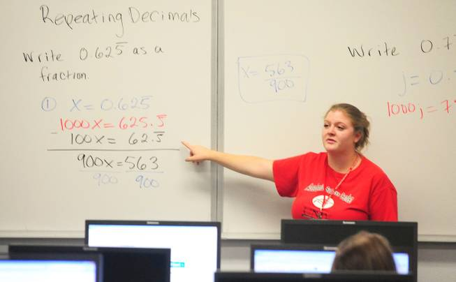 Tutor Megan Bavaro teaches a math concept at UNLV's Summer Bridge program on Tuesday, July 17, 2012. The new program helps incoming freshmen avoid costly remedial math courses by preparing them for five weeks over the summer to pass a math proficiency exam that places them into a college-level math course.