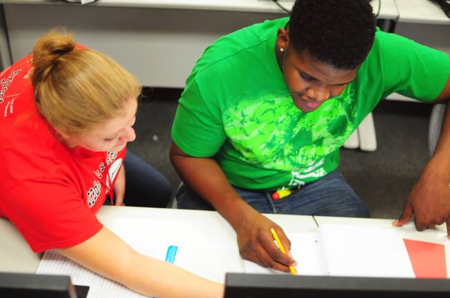 Tutor Megan Bavaro helps Sevaughn Thomas, 18,  at UNLV's Summer Bridge program on Tuesday, July 17, 2012. The new program helps incoming freshmen avoid costly remedial math courses by preparing them for five weeks over the summer to pass a math proficiency exam that places them into a college-level math course.