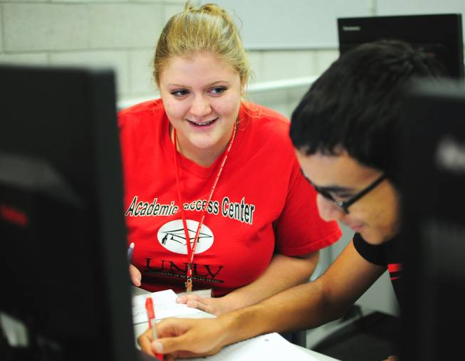 Tutor Megan Bavaro helps Isaac Robinson, 18, with a math problem at UNLV's Summer Bridge program on Tuesday, July 17, 2012. The new program helps incoming freshmen avoid costly remedial math courses by preparing them for five weeks over the summer to pass a math proficiency exam that places them into a college-level math course.