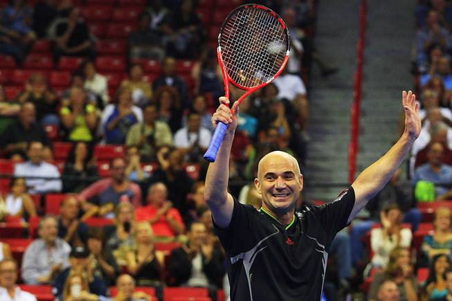 Andre Agassi waves to the crowd after defeating Jim Courier during the Las Vegas stop of the 2011 Champions Series Tennis tournament Saturday, Oct. 15, 2011. Agassi won last year's event and will headline this year's tour stop at Mandalay Bay on Nov. 17.