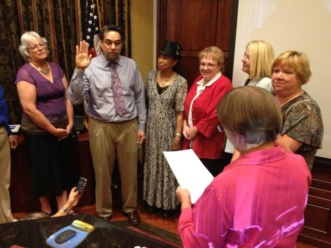 Rene Cantu Jr., center, is sworn in as the District E representative on the Clark County School Board on Thursday, July 19, 2012, as other School Board members watch. From left are, Carolyn Edwards, Cantu, Board President Linda Young, Chris Garvey, Lorraine Alderman and Deanna Wright, Cantu, executive director of the Las Vegas Latin Chamber of Commerce, will serve the remaining five months of the term ending Jan. 7, 2013.