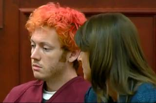 In this image taken from video provided by KUSA.com, James Holmes, left, the suspected gunman in Friday's Colorado theater massacre, makes his first appearance in court with his attorney in Aurora, Colo., Monday, July 23, 2012.