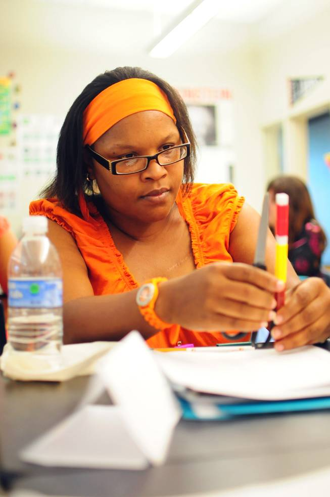 Gilbert Elementary School fourth grade teacher Monique Brass participates in a summer training session on Tuesday, July 24, 2012. More than 5,000 Clark County School District teachers are taking unprecedented professional development opportunities over the summer in a district-wide initiative to boost student achievement in the upcoming school year.