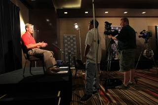 UNLV head football coach Bobby Hauck takes part in the Mountain West Conference football media day Tuesday, July 24, 2012.