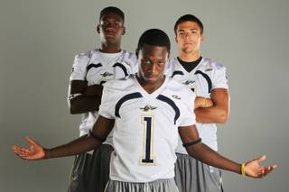 Cheyenne football players Darius Gantt, Devin Tatum and Dylan Power Thursday, July 26, 2012.