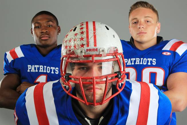 Liberty football players Jay Mitchell, Christopher Noone and Phoenix Uptain Thursday, July 26, 2012.