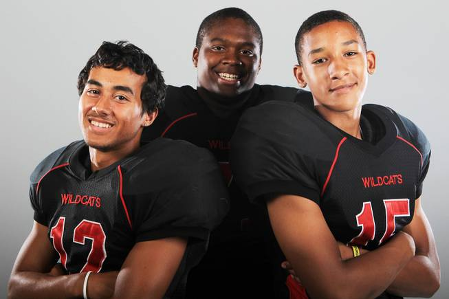 Las Vegas football players Vince Castro, Lahmed Evans and Joshua Mayfield Thursday, July 26, 2012.