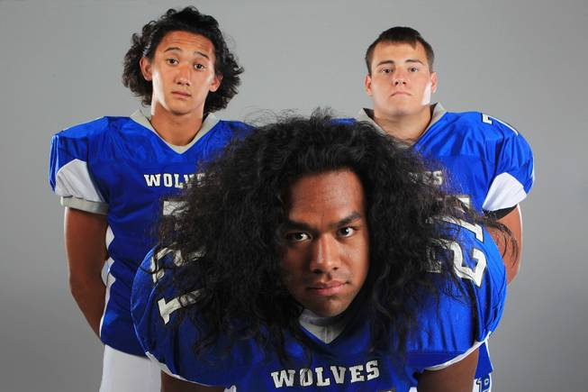 Basic football players Anthony Owens, Mike Roberts and Ian Bates Thursday, July 26, 2012.