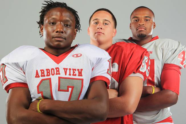 Arbor View football players Donnie Gaskin, Steven Davis and Rasheed Parks Thursday, July 26, 2012.